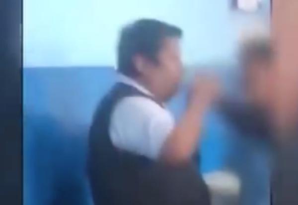 video-maestro-toma-licor-alumnos-ventanilla